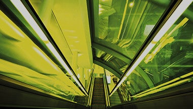 yellow escalator staircase